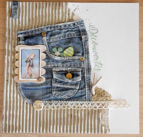 page de scrapbooking avec du carton, du jean, de la broderie.